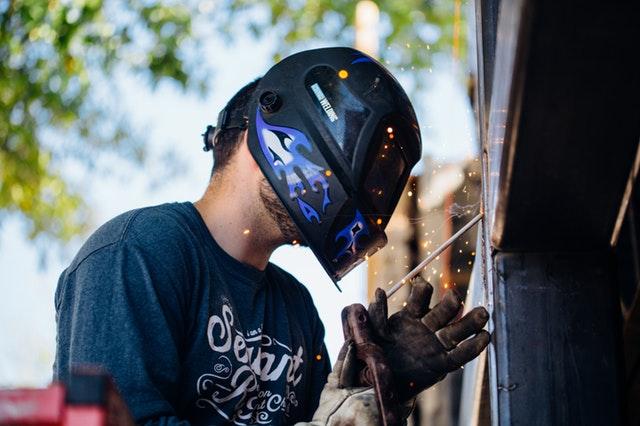 Man fixing building